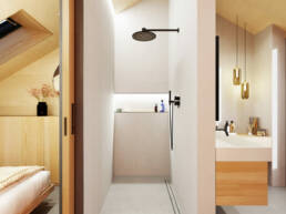 Eine große, begehbare Dusche grenzt an das große Badezimmer.
