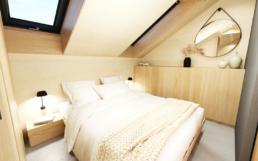 In dem Schlafzimmer befindet sich ein großes Doppelbett und Einbauschränke