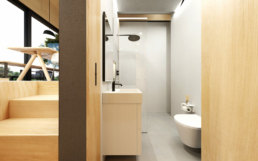 Das kleine Badezimmer hat eine begehbare Dusche und einen Lichtschacht für Tageslicht